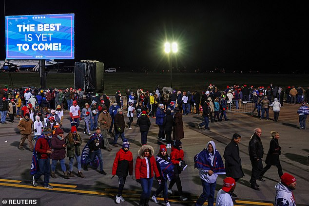 The temperature was reportedly 41F degrees at the time when the hordes of people got stranded waiting for nearly two hours for the shuttles after the rally in Pennsylvania. A view of supporters leaving the rally in winter coats and hats above
