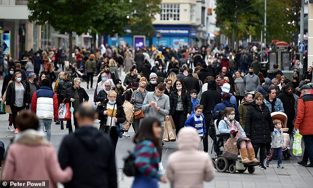 Crowds of shoppers are seen loading up on non-essential items ahead of the month-long lockdown