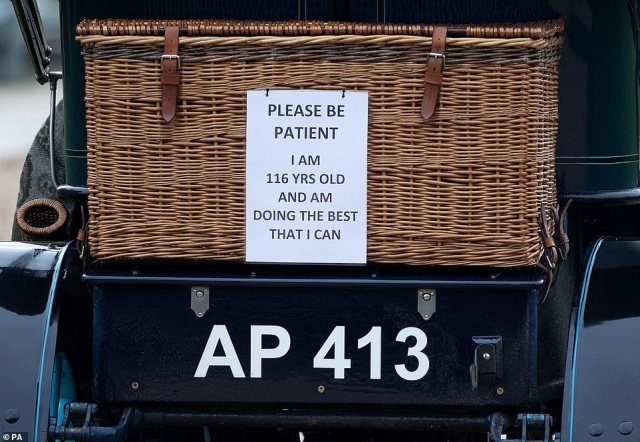 A 'Please be patient' sign on the back of a 1904 Humberette as it is driven into the grounds of Beaulieu House. The Run, which usually involves drivers starting at Hyde Park before embarking on a 60-mile journey that ends on the iconic Brighton seafront, was cancelled on October 16 due to the pandemic and instead motorists are being encouraged to take their cars out for a nearby drive to celebrate