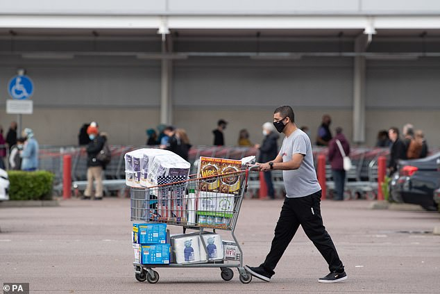 Shoppers at Costco in Leicester, after Prime Minister Boris Johnson announced a new national lockdown will come into force in England next week