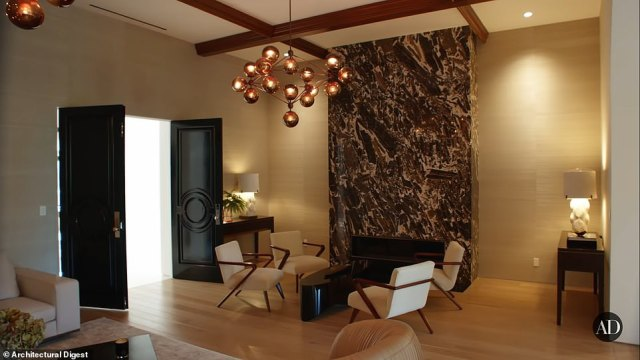 A view of an elegant and modern living room for entertaining guests in the massive home pictured above