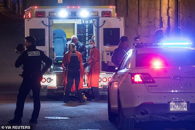 A person is treated by an ambulance crew in an area where multiple people were stabbed near the Parliament Hill area of Quebec City