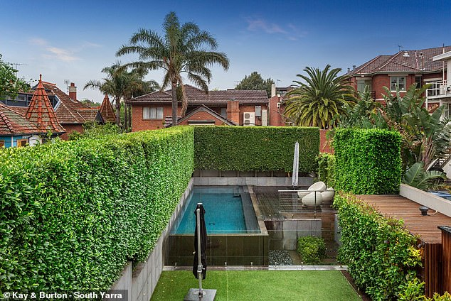 Other features include a children's playroom, a large underground cellar, an elevated swimming pool, landscaped gardens, hydronic heating and cooling, underfloor heating in the tiled areas
