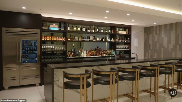 The ground floor of the home features a decked out bar complete with fridge, making it the perfect place to kick back with some cocktails