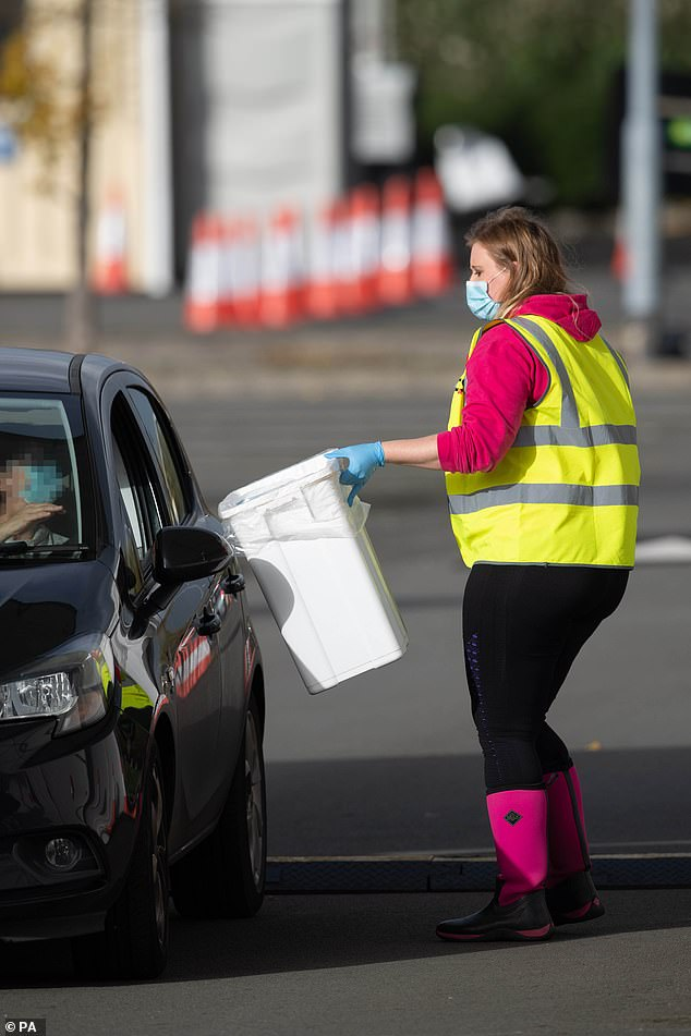 Swabs are collected at a Covid-19 testing site in Leicester, November 1