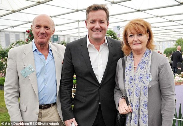 Hard times:The star spoke on Good Morning Britain about how his mum and step-dad, Gabrielle and Glynne Pughe-Morgan, have fought the disease over a 'scary fortnight' (Piers and his parents, pictured in 2012)