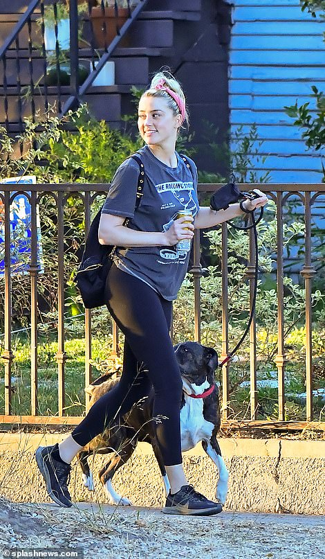 Heard looked happy and relaxed this morning as she was pictured in Los Angeles taking her dog for a walk before the verdict