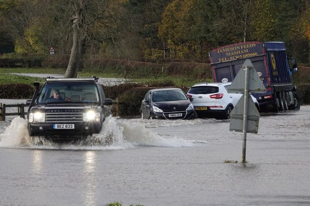 Firefighters had to rescue stranded motorists on Sunday after a fortnight's worth of rain brought by Storm Aiden fell in just 24 hours. Pictured: Flooding on roads in North Yorkshire after the River Ure burst its banks