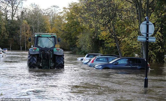 This car park in Wetherby, West Yorkshire, was also flooded after the heavy rain fall yesterday. It prompted a farmer to drive through the water in a tractor