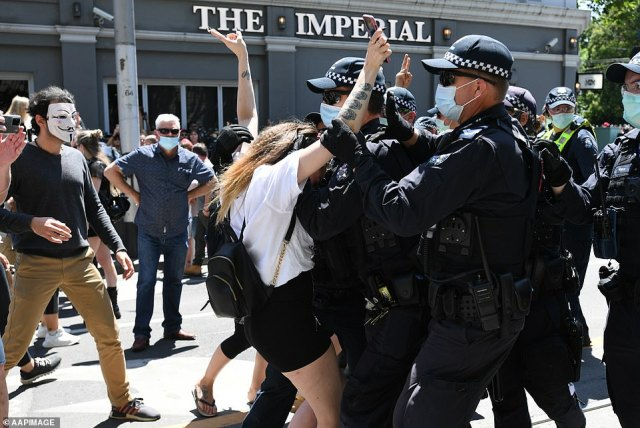 Melburnians have celebrated Melbourne Cup Day in an extremely different fashion to Sydneysiders, with hundreds of protesters taking to the streets (pictured) in a 'Freedom Day' rally calling forVictorian premier Daniel Andrews to be sacked