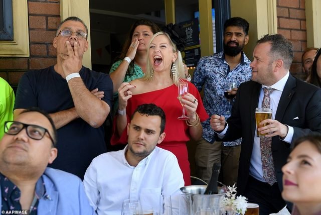 Sydneysiders pictured watching the race that stops the nation at the Harbour View Hotel in The Rocks