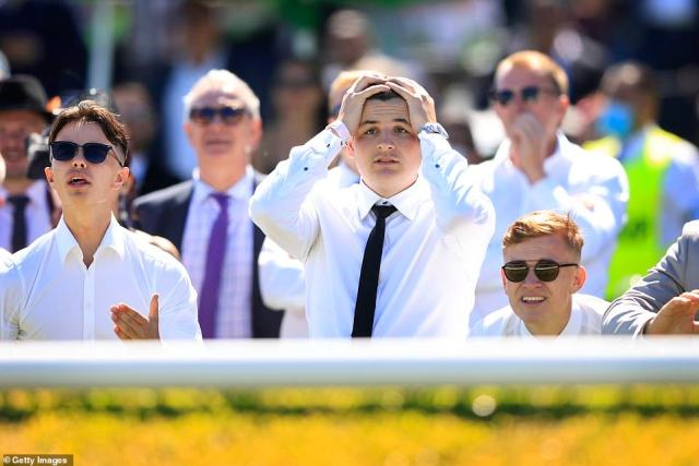 Punters at Randwick Racecourse in Sydney anxiously watched the Melbourne Cup race on a big screen (pictured on Tuesday)