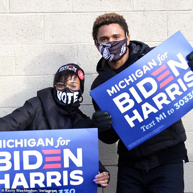 Vote mask: She also wore a black Biden-Harris stocking cap and glasses with gold hoop earrings and a black face mask that simply said VOTE in big white letters