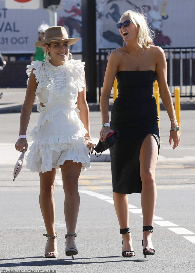 Melbourne Cup punters and racegoers are pictured in various moods at Sydney's Randwick Racecourse for the Melbourne Cup