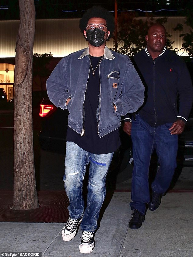 Fashion:The Weeknd styled his look with a pair of blue distressed jeans and a pair of platform Converse, while accessorising with a palm tree pendant necklace.