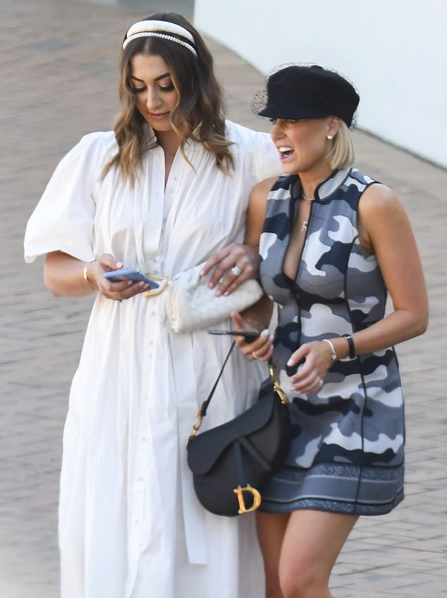 A steady presence: The animated PR queen leaned on her pal as they walked along