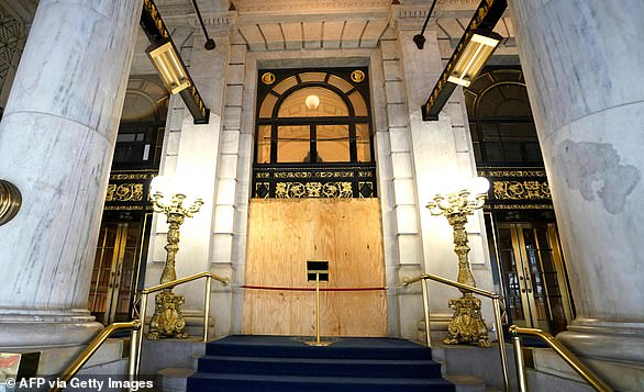 The above image shows the entrance to the Plaza Hotel, which is located on the corner of Fifth Avenue and Central Park South
