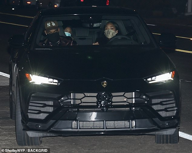 Squad: Jordyn was seen arriving in her black Lamborghini with her beau and a female pal who was sat in the black of the car
