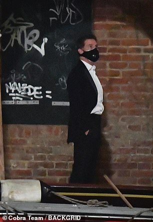 Staying safe: While he wasn't filming Tom made sure to keep safe amid the coronavirus crisis by wearing a black face mask that appeared to have two layers of protection