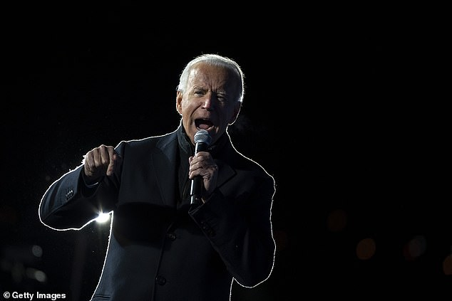 Democratic presidential nominee Joe Biden speaks during a drive-in campaign rally at Lexington Technology Park on November 2
