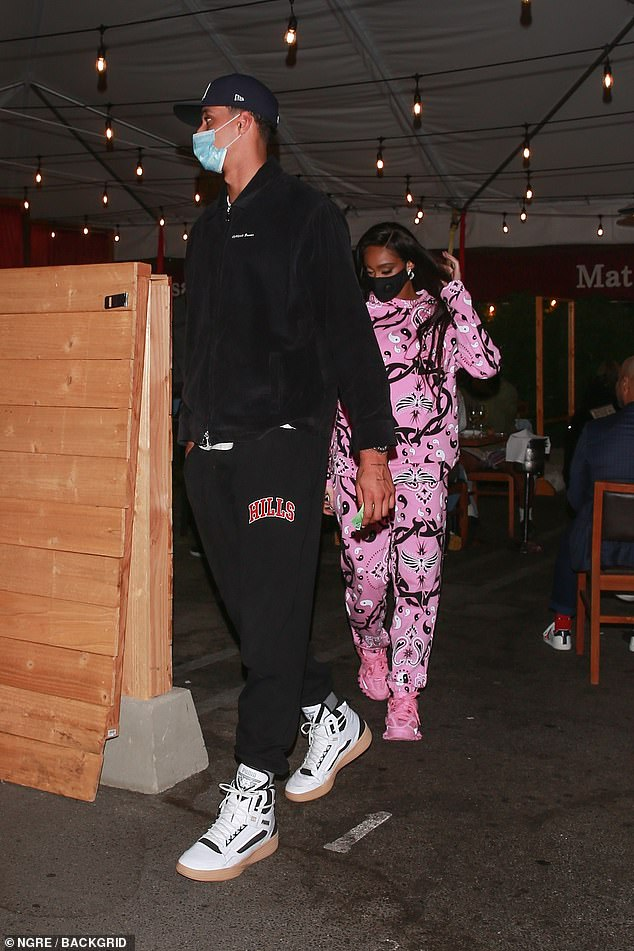 Closer than ever: Winnie Harlow and Kyle Kuzma proved inseparable as they enjoyed a dinner date in Beverly Hills on Monday evening