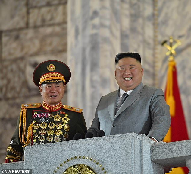 Tim Peters, a Christian activist, claimed coronavirus 'quarantine camps' have been set up in cities near the Chinese border. Above, North Korean leader Kim Jong Un smiles during a ceremony to celebrate the 75th anniversary of the country's ruling party in Pyongyang on October 10