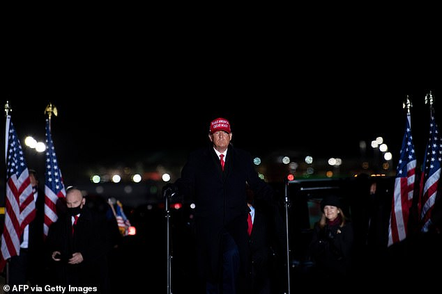 President Donald Trump enters the final rally of his 2020 presidential campaign in Grand Rapids, Michigan