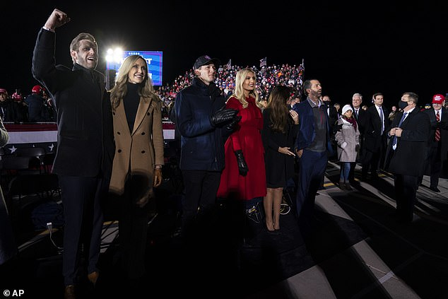 Eric Trump and his wife Lara Trump, Ivanka Trump and her husband Jared Kushner, and Donald Trump Jr., and his girlfriend Kimberly Guilfoyle, listen as President Donald Trump speaks at his final rally in Grand Rapids, Michigan