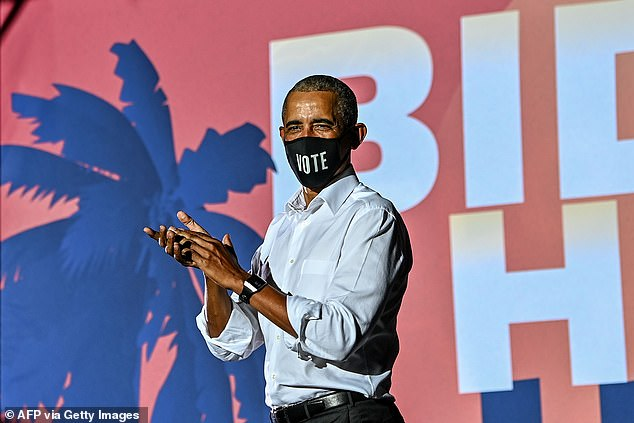 Former US President Barack Obama speaks at a drive-in rally as he campaigns for Democratic presidential candidate former Vice President Joe Biden in Miami, Florida on November 2