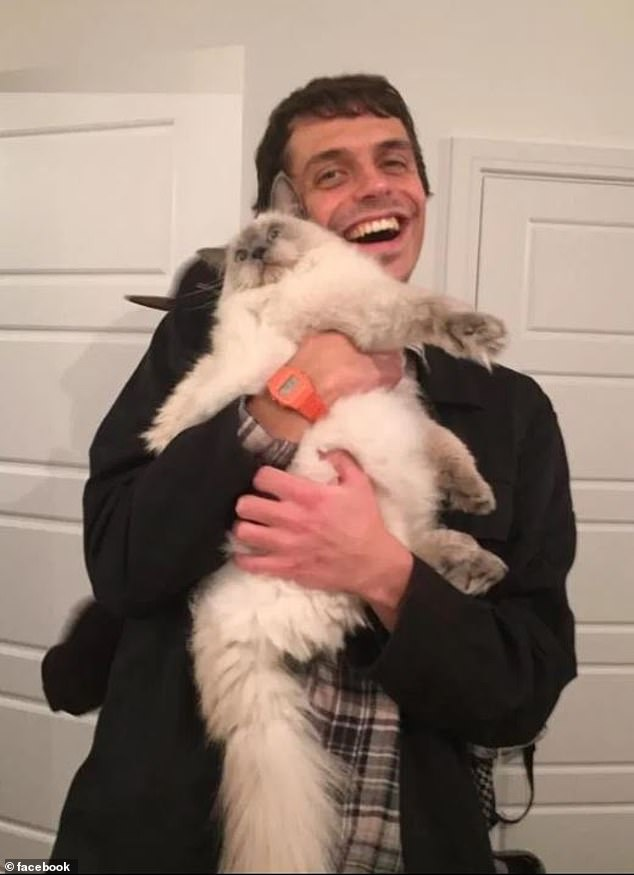 Adam Lawrence, 29, from Ealing, West London, shared a picture of him with a fluffy white cat in the This Cat is Chonky Facebook group last year (pictured) and his now fiancee thought he looked 'cute'