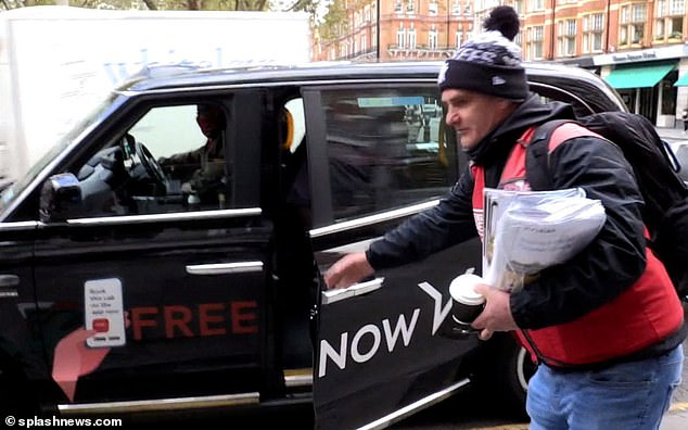 Helpful: The Big Issue seller helped to close the taxi door for Joan and Percy