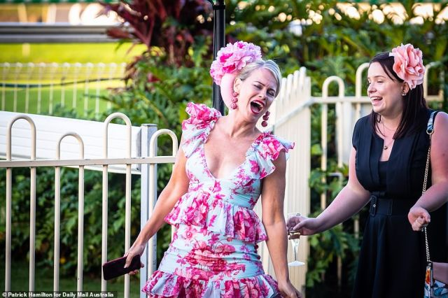 Another appeared to be singing out with joy as she arrived at the racecourse alongside a close friend at Dooben Race Course in Brisbane