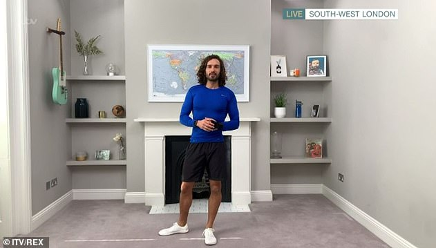 Healthy:Joe was awarded an MBE and claimed a Guinness World Record for live streaming after one of his online classes attracted almost a million viewers (pictured in March)