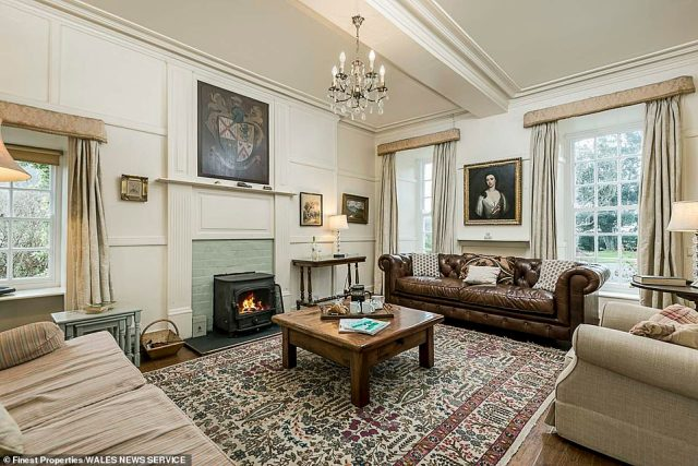 The sitting area inside the main house, with an ornate fireplace and family portrait seen hanging on the wall.The family, who have links to Welsh royalty, built their wealth on farming and shipping timber and wool 3,000 miles from Wales to America