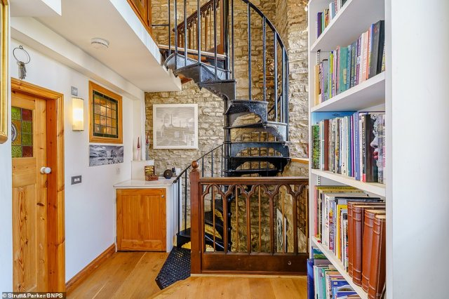 Askrigg Chapel features a wrought iron staircase (pictured) designed by Yorkshire sculptor Craig Dyson, who also curated a bespoke bar inside the home