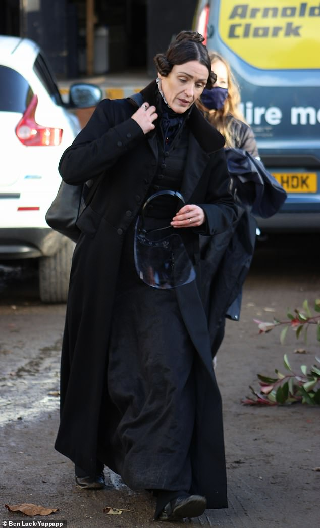 Back to work: Suranne Jones transformed into Anne Lister in a black dress as she arrived on set of Gentleman Jack's second season in West Yorkshire on Monday