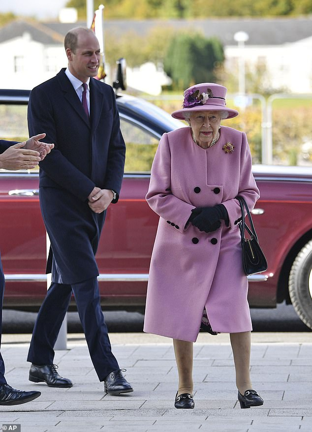 The Queen (pictured with Prince William in October) was 'worried' when her two direct heirs - Prince William and the Prince of Wales - contracted COVID-19, a royal insider has claimed