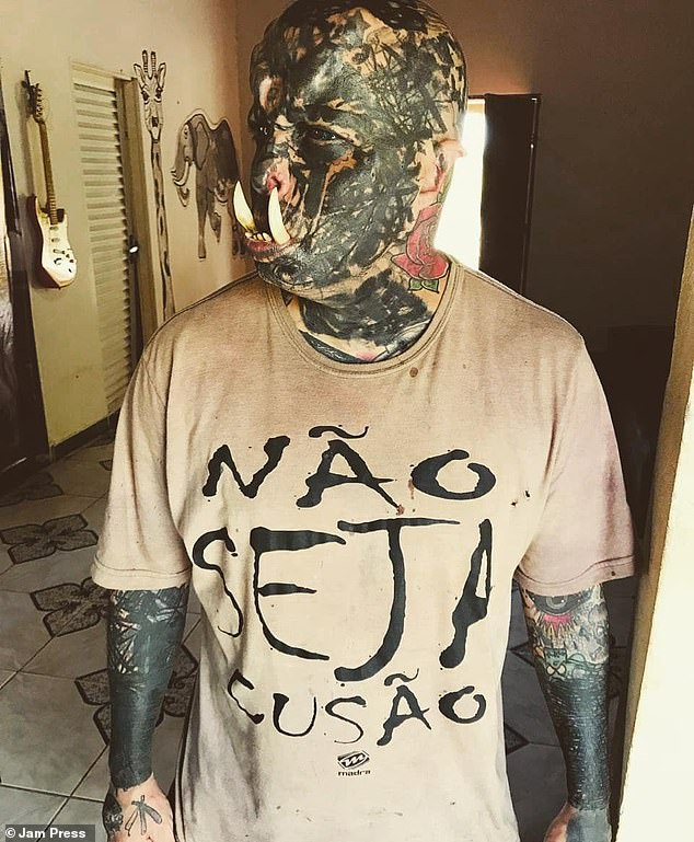 Brazilian tattoo artist 'Orc' (pictured) has spent £400 on a pair of giant tusks to complete his look