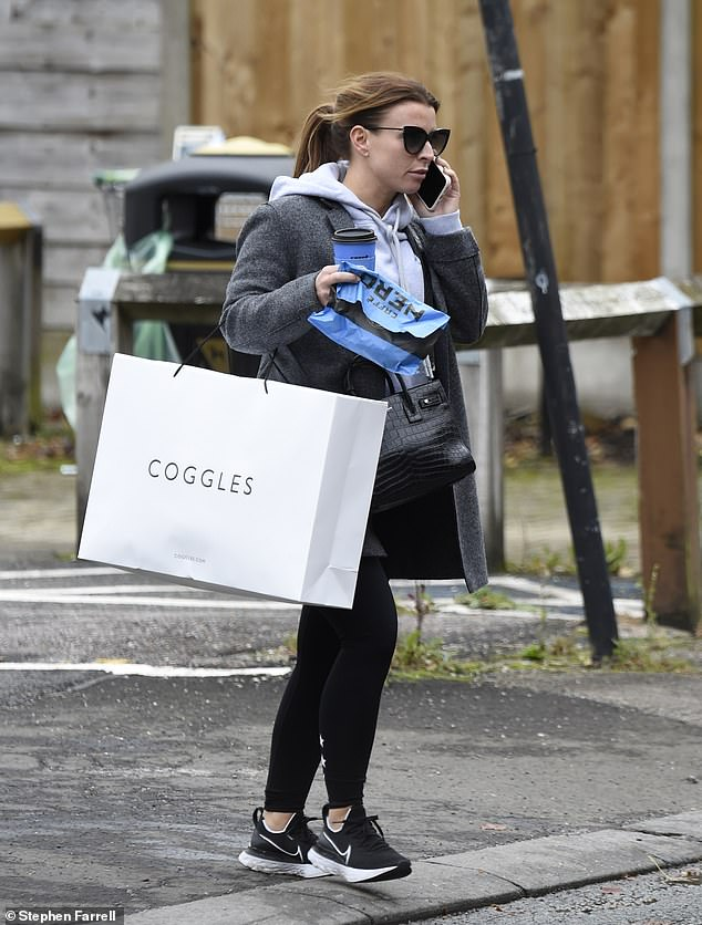 Last minute trip: Coleen Rooney enjoyed a spot of retail therapy as she headed to designer store Coggles in Alderley Edge, Cheshire on Wednesday
