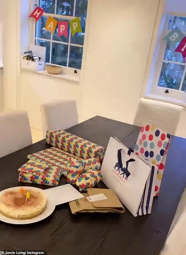 Big effort: Heading downstairs, Jamie was surprised with a table piled with presents lovingly wrapped by Habbs alongside a banoffee pie, while bunting was placed on the windows