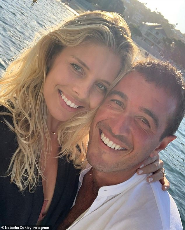 The 30-year-old model wrote of her businessman beau: 'Two years. Lucky to love and be loved by you'