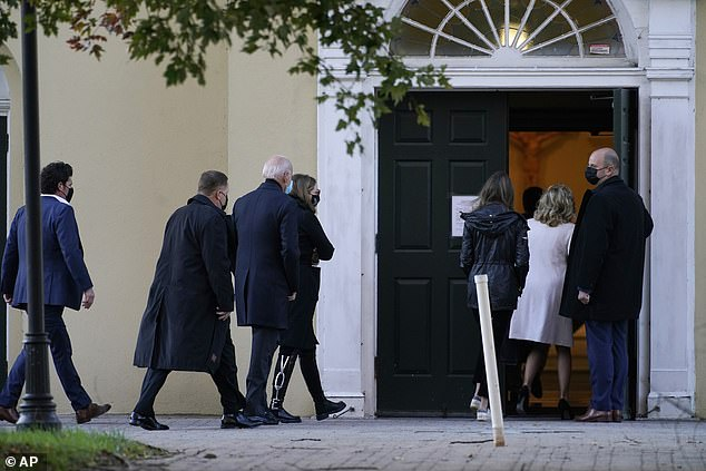 The Democratic presidential candidate was seen walking into St. Joseph On the Brandywine Catholic Church in Wilmington with his wife Jill and granddaughters Finnegan and Natalie soon after 7 a.m. Tuesday (above)