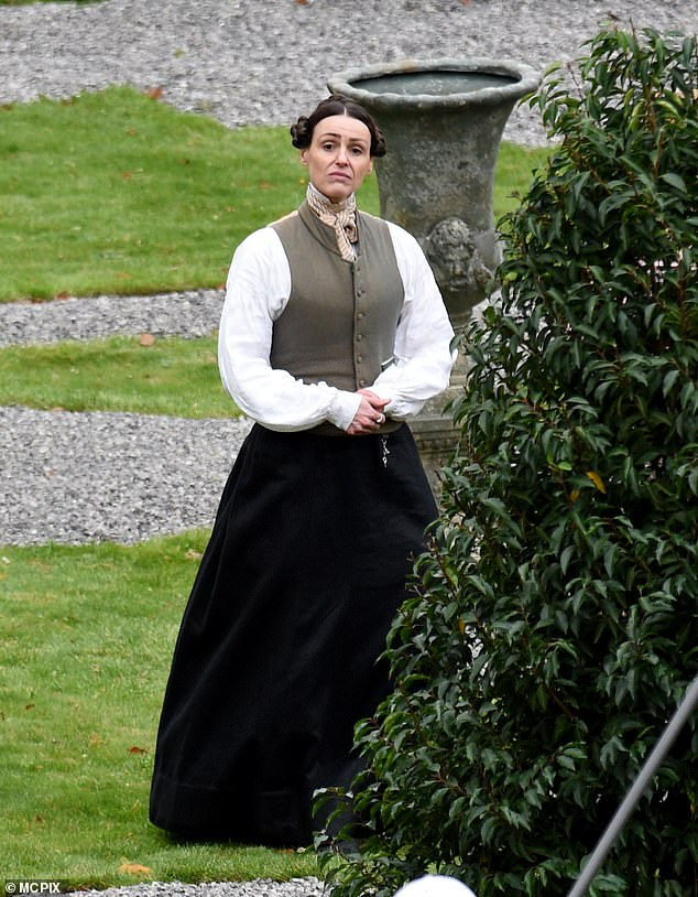 In character: Suranne was seen surveying the pristine gardens during the scene