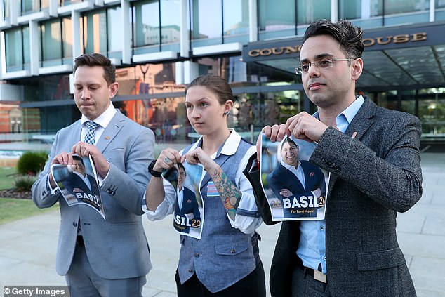 Members from theLGBTIQ community are seen tearing up a photo of Mr Zempilas following his 'disgusting' comments about transgender people