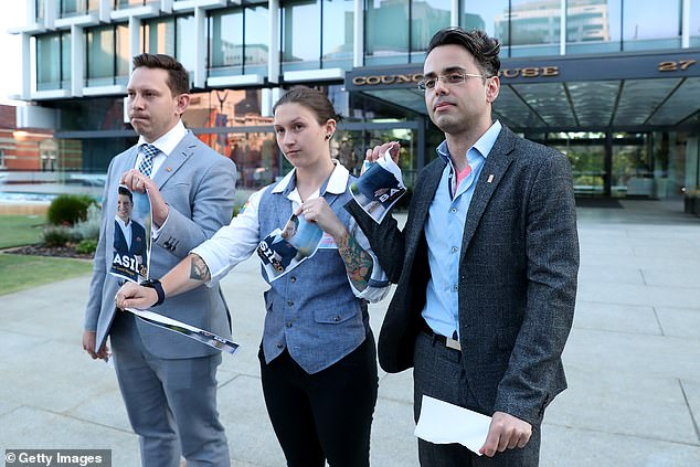 Former President of Pride WA, Paul van Lieshout Hunt, Sarah Feldman and David Goncalves tear up posters of the newly elected Lord Mayor