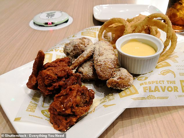 Along with its popular wings (pictured), Wingstop has began trialling bone-in chicken thighs as a way to counter the rising cost of wings [File photo]