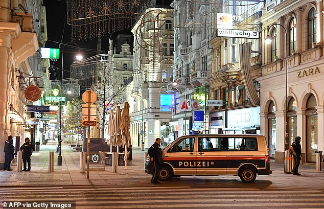 A police van blocks a thoroughfare in Vienna after a gunman went on a rampage through city