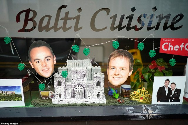 Getting into the spirits: I'm A Celebrity fans in Abergele village decked their shop windows with Ant and Dec cutouts, stuffed animals, and other decorations on Tuesday
