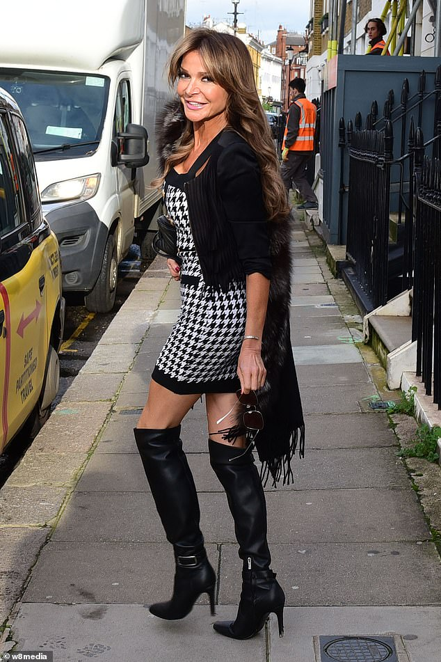 Wow:Lizzie Cundy looked sensational as she stepped out to enjoy a meal at Annabel's on Tuesday before England's second national lockdown