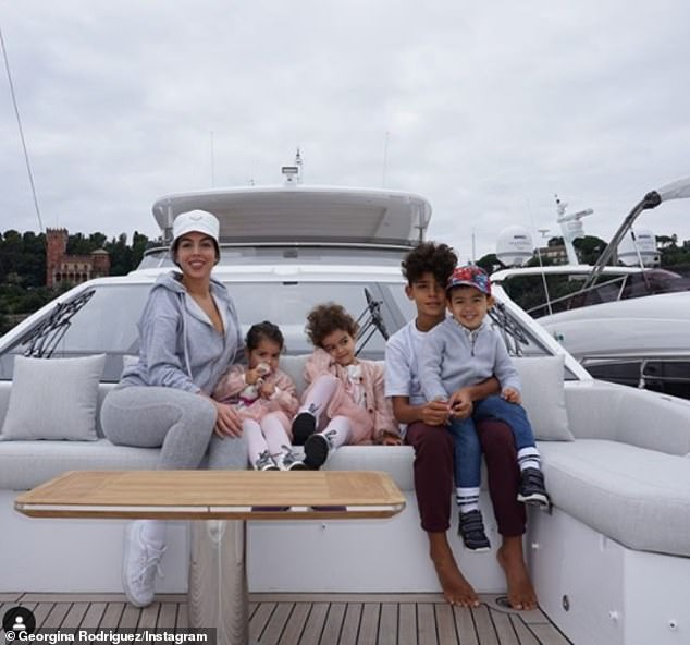 So sweet: Georgina's post comes a day after she shared a sweet family snap of herself on a yacht with the young family she shares with Portuguese forward Cristiano